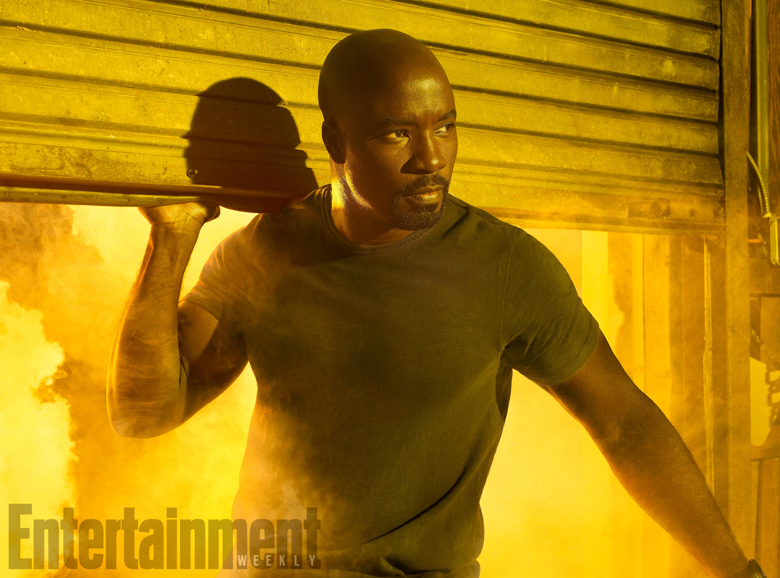 The Defenders, Mike Colter (as Luke Cage), photographed for Entertainment Weekly on December 10th, 2016, by Finlay Mackay in Brooklyn, New York. Costume Designer: Stephanie Maslansky, Wardrobe Supervisor: Pahelle Latino, Makeup Head: Sarit Klein, Key Makeup Artist: Kaela Dobson, Hair Department Head: Pamela May, FX Makeup: Brian Spears, Prop Stylist: Charlot Malmlof